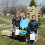 Tropical Wings poetry contest winners, (left to right) Karen Schulz, Maggie Brown, and Joey  Olsen, who read their poems on Saturday, May 3, at the art bench in Larry Forrest Memorial Park, Somerset, Wisconsin.